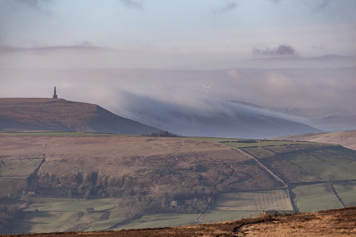 Fog rising behind Stoodley Pike monument